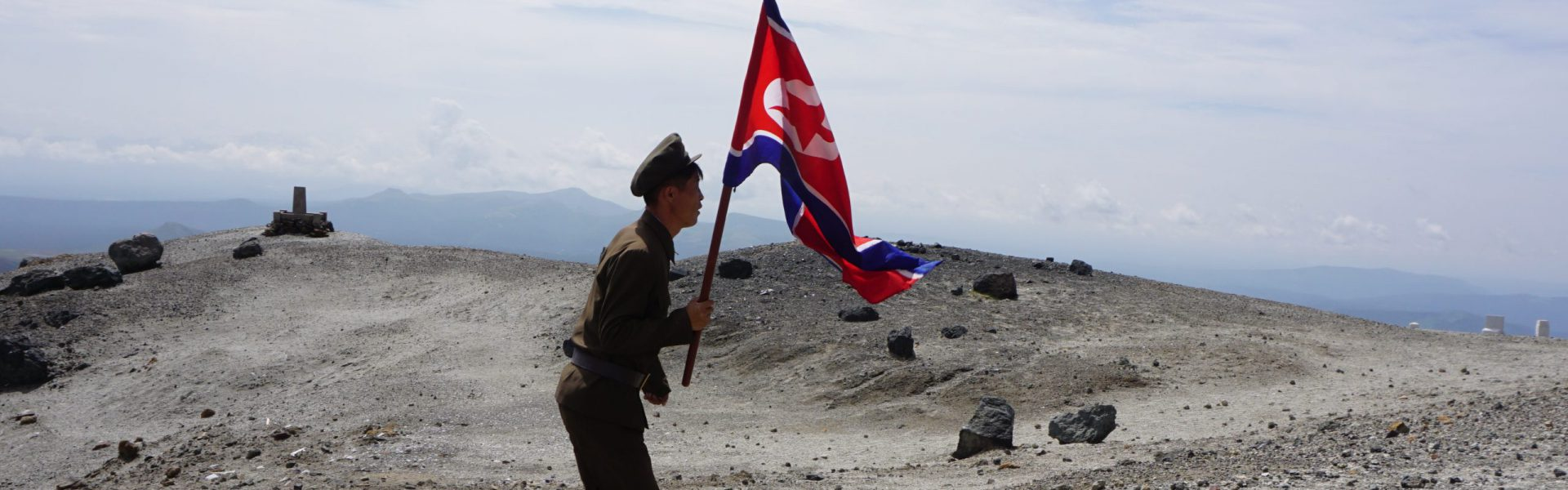A soldier carrying a flag on Mt. Paektu, North Korea