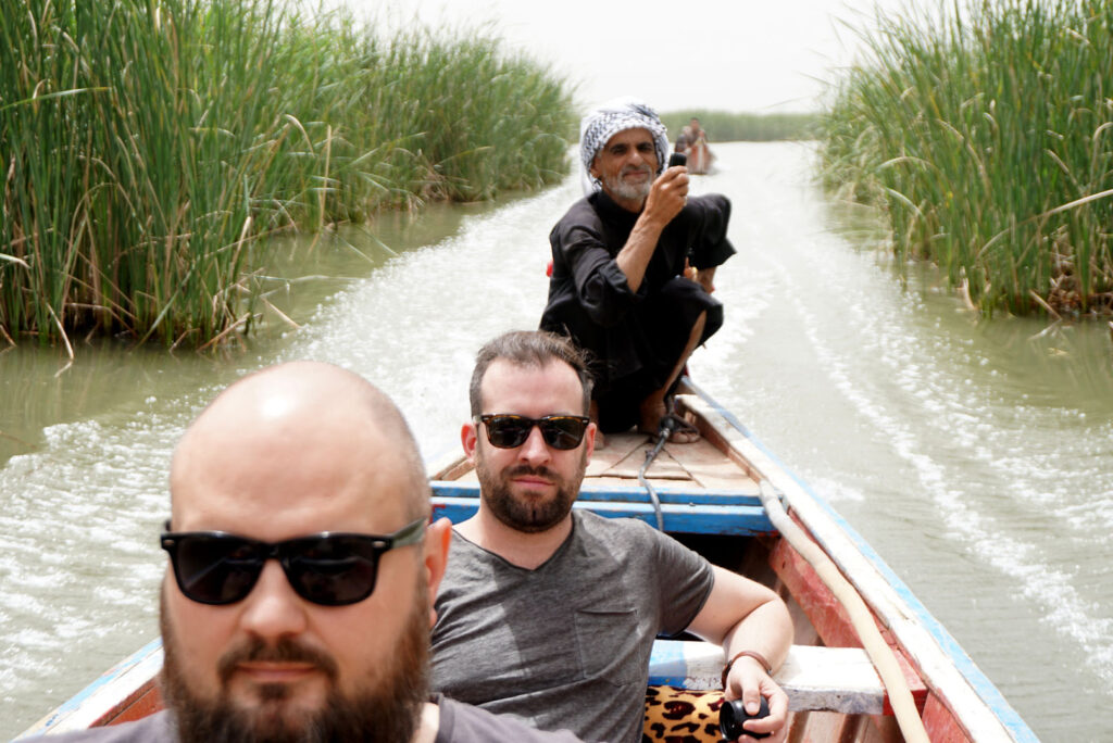 Cruising in a boat through the marshes in Iraq